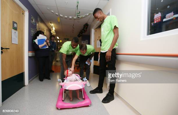 Manchester City's Kelechi Iheanacho Aleix Garcia and Tosin Adarabioyo with a patient while visiting Royal Manchester Childrenv¢¬Ä¬ôs Hospital