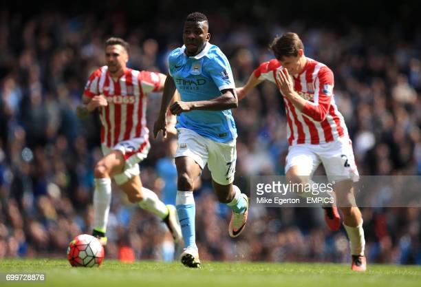 Manchester City's Kelechi Iheanacho races clear of Stoke City's Philipp Wollschield to score their fourth goal