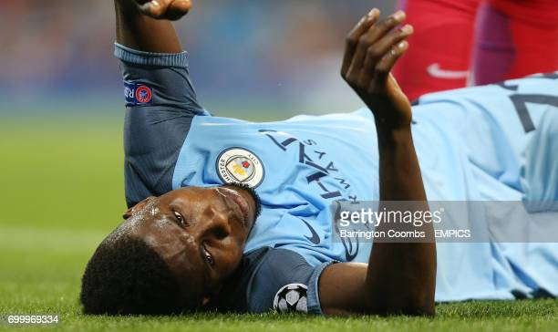 Manchester City's Kelechi Iheanacho receives help from Steaua Bucharest's Bogdan Mitrea after going down injured