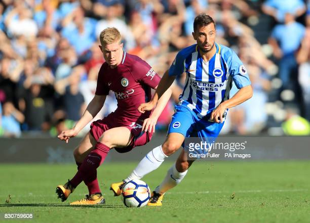 Manchester City's Kevin De Bruyne and Brighton Hove Albion's Markus Suttner battle for the ball during the Premier League match at the AMEX Stadium...