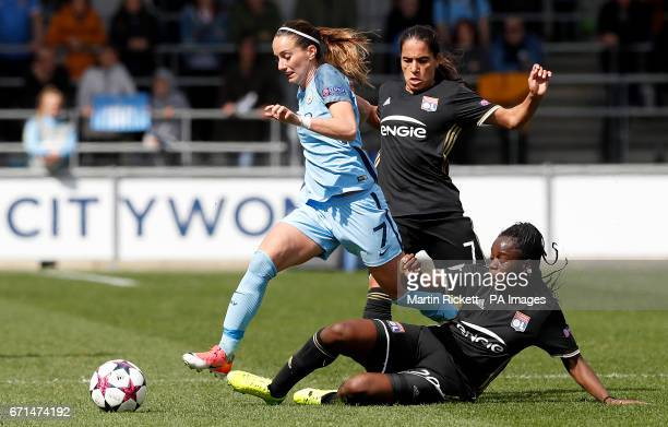 Manchester City's Kosovare Asllani battles for the ball with Olympique Lyonnais Amel Majri and Griedge Mbock Bathy during the UEFA Women's Champions...