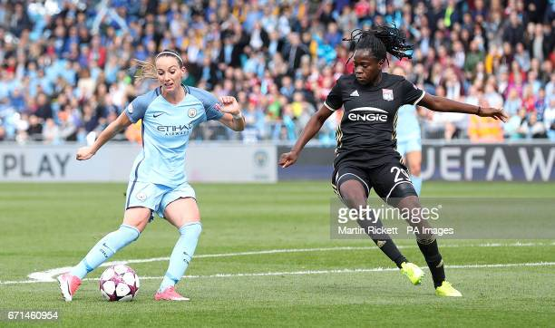 Manchester City's Kosovare Asllani scores his team's first goal past Olympique Lyonnais' Griedge Mbock Bathy during the UEFA Women's Champions League...