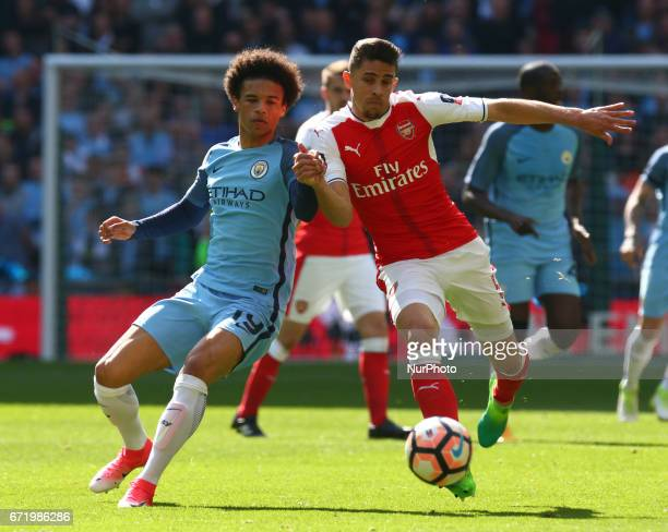 Manchester City's Leroy Sane against Arsenal's Gabriel Paulista during The Emirates FA Cup SemiFinal match between Arsenal and Manchester City at...