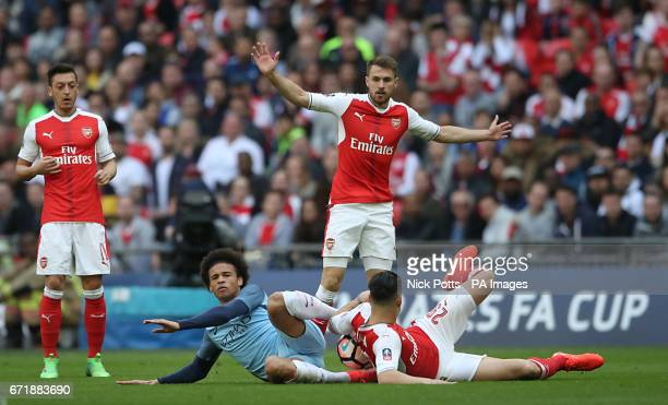 Manchester City's Leroy Sane and Arsenal's Granit Xhaka on the ground during the Emirates FA Cup Semi Final match at Wembley Stadium London