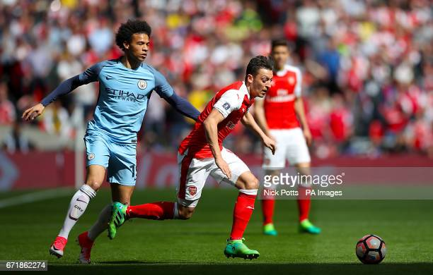 Manchester City's Leroy Sane and Arsenal's Mesut Ozil battle for the ball during the Emirates FA Cup Semi Final match at Wembley Stadium London