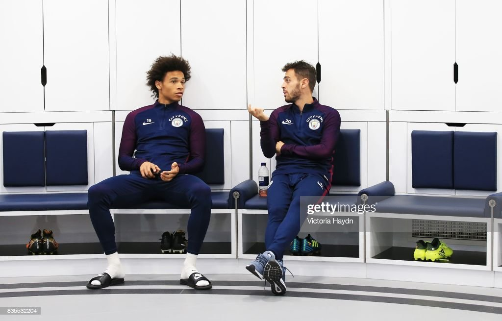 Manchester City's Leroy Sane and Bernardo Silva talk in the dressing room during their first visit to the new facilities at Etihad Stadium on August 19, 2017 in Manchester, England.