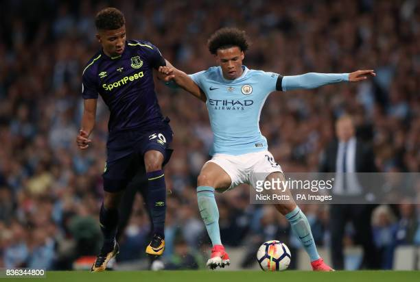 Manchester City's Leroy Sane and Everton's Mason Holgate battle for the ball during the Premier League match at the Etihad Stadium Manchester