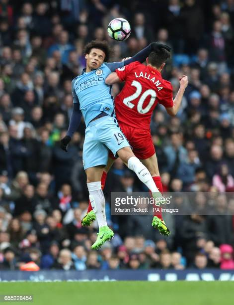 Manchester City's Leroy Sane and Liverpool's Adam Lallana battle for the ball during the Premier League match at the Etihad Stadium Manchester
