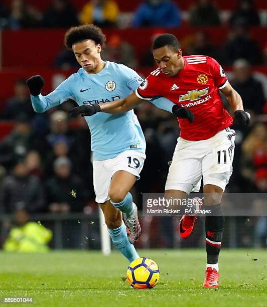 Manchester City's Leroy Sane and Manchester United's Anthony Martial battle for the ball during the Premier League match at Old Trafford Manchester