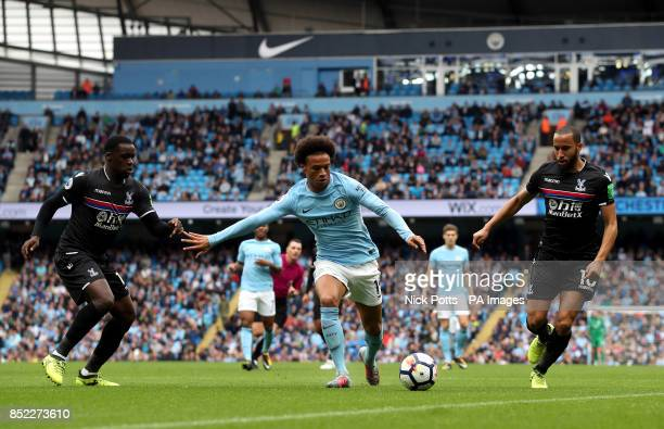 Manchester City's Leroy Sane battles for the ball with Crystal Palace's Andros Townsend and Jeffrey Schlupp during the Premier League match at the...