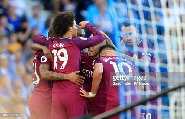 Manchester City's Leroy Sane celebrates a second goal for their side after Brighton Hove Albion's Lewis Dunk scores an owngoal during the Premier...