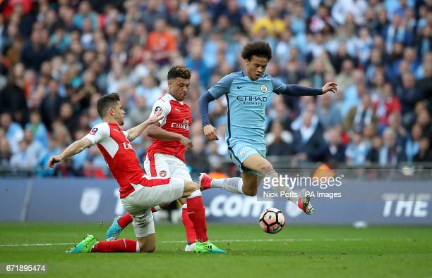Manchester City's Leroy Sane in action against Arsenal's Gabriel Paulista and Alex OxladeChamberlain during the Emirates FA Cup Semi Final match at...
