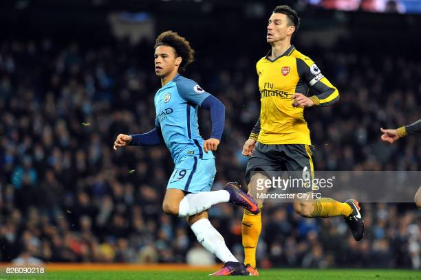 Manchester City's Leroy Sane runs past Arsenal's Laurent Koscielny to celebrate his goal during the Barclay's Premiership match at the Etihad Stadium...