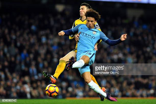 Manchester City's Leroy Sane runs past Arsenal's Laurent Koscielny to equalize during the Barclay's Premiership match at the Etihad Stadium...