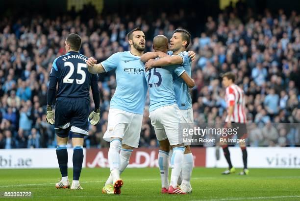 Manchester City's Luis Fernandinho celebrates scoring his side's first goal of the game with teammates Sergio Aguero and Alvaro Negredo