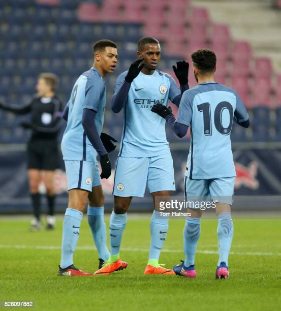 Manchester City's Lukas Nmecha celebrates scoring with Saido Diallo and Paolo Fernandes in action