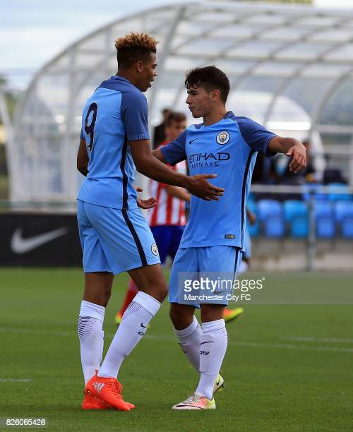 Manchester City's Lukas Nmecha celebrates with Brahim Diaz after he scores his sides third goal from the penalty spot