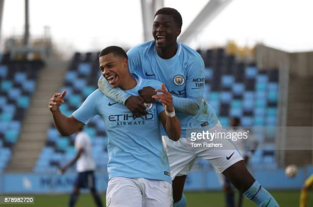 Manchester City's Lukas Nmecha celebrates with Taylor Richards after scoring to make it 32 during the Premier League 2 match between Manchester City...