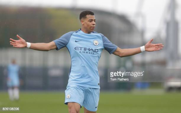 Manchester City's Lukas Nmecha in action against Manchester United