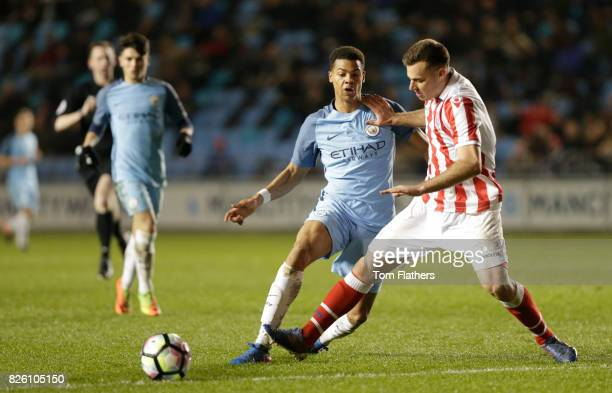 Manchester City's Lukas Nmecha in action against Stoke