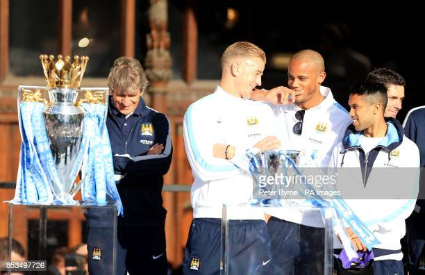 Manchester City's Manuel Pellegrini Joe Hart Vincent Kompany and Gael Clichy during the Barclays Premier League Victory Parade in Manchester