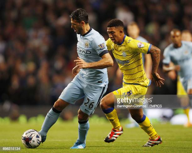 Manchester City's Martin Demichelis and Sheffield Wednesday's Liam Palmer