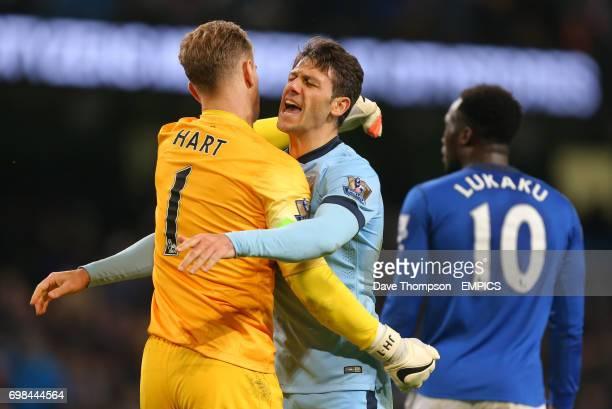 Manchester City's Martin Demichelis celebrates with Manchester City's Joe Hart