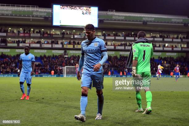 Manchester City's Martin Demichelis leaves the pitch dejected