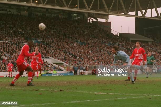 Manchester City's Maurizio Gaudino scores the winning goal
