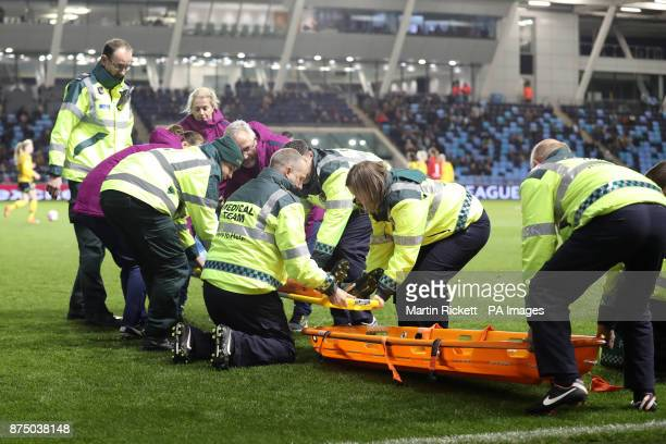 Manchester City's Megan Campbell leaves the field injured on a stretcher during the UEFA Women's Champions League match at the City Football Academy...
