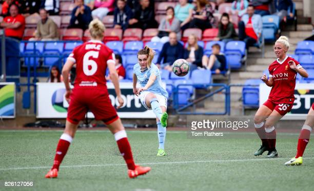 Manchester City's Melissa Lawley scores against Liverpool