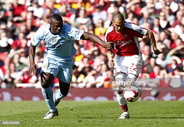 Manchester City's Micah Richards and Arsenal's Gael Clichy battle for the ball