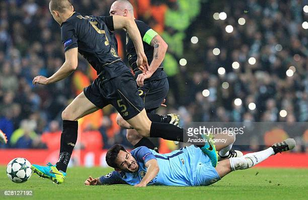 Manchester Citys midfielder Ilkay Gundogan is fouled by Celtic's striker Scott Brown during the Champions League Group C stage soccer match between...