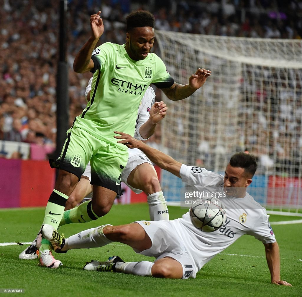 Manchester City's midfielder Raheem Sterling (L) vies with Real Madrid's midfielder Lucas Vazquez during the UEFA Champions League semi-final second leg football match Real Madrid CF vs Manchester City FC at the Santiago Bernabeu stadium in Madrid, on May 4, 2016. / AFP / GERARD