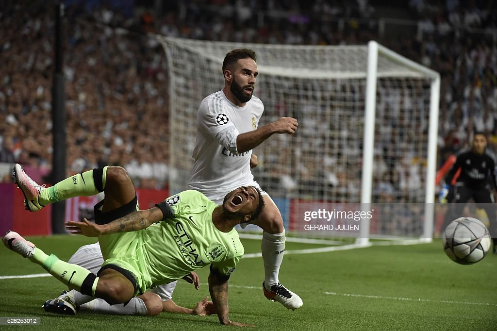 Manchester City's midfielder Raheem Sterling (L) vies with Real Madrid's defender Dani Carvajal during the UEFA Champions League semi-final second leg football match Real Madrid CF vs Manchester City FC at the Santiago Bernabeu stadium in Madrid, on May 4, 2016. / AFP / GERARD