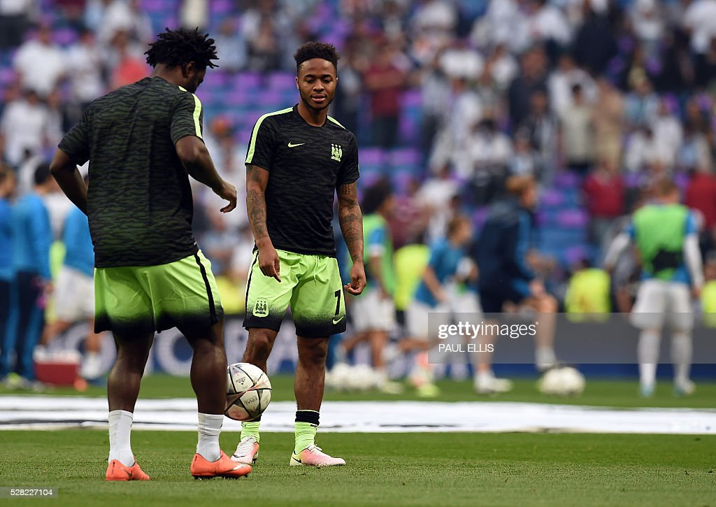 Manchester City's midfielder Raheem Sterling (R) warms up before the UEFA Champions League semi-final second leg football match Real Madrid CF vs Manchester City FC at the Santiago Bernabeu stadium in Madrid, on May 4, 2016. / AFP / PAUL