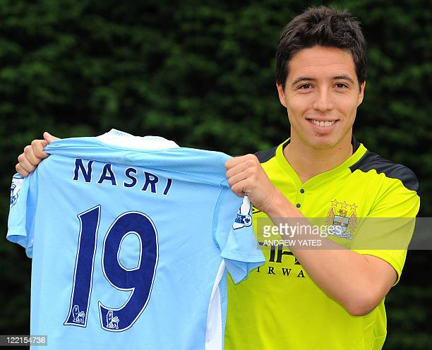 Manchester City's new signing French midfielder Samir Nasri poses for photographers at the club's Carrington training complex in Manchester northwest...