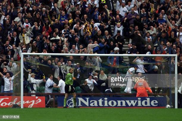 Manchester City's Nicky Weaver goes to pick the ball out of the net as fans celebrate after Preston North End's Jon Macken's chipped a goal from near...