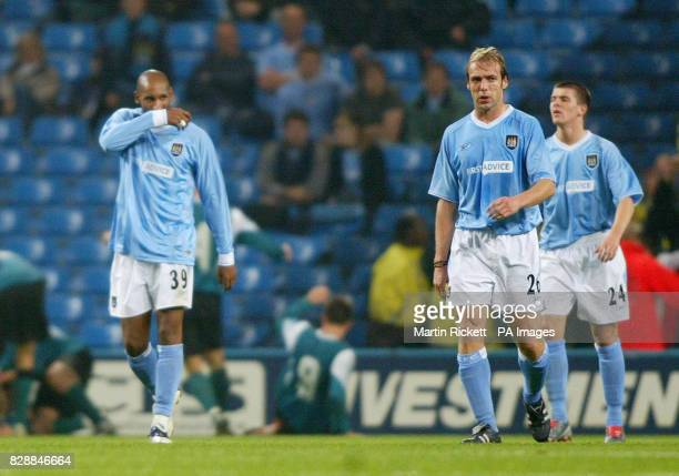 Manchester City's Nicolas Anelka Paul Bosvelt and Joey Barton show their dejection after Groclin Dyskobolia scored from a free kick during the UEFA...