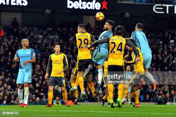 Manchester City's Nicolas Otamendi and Aleksandar Kolarov and Arsenal's Granit Xhaka in action during the Barclay's Premiership match at the Etihad...