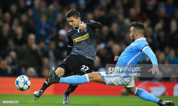 Manchester City's Nicolas Otamendi and Borussia Monchengladbach's Julian Korb battle for the ball