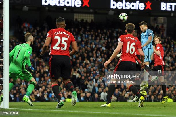 Manchester City's Nicolas Otamendi and Manchester United's David De Gea in action during the Barclay's Premiership match at the Etihad Stadium...