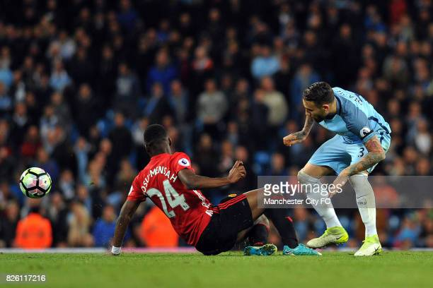 Manchester City's Nicolas Otamendi and Manchester United's Timothy FosuMensah in action during the Barclay's Premiership match at the Etihad Stadium...