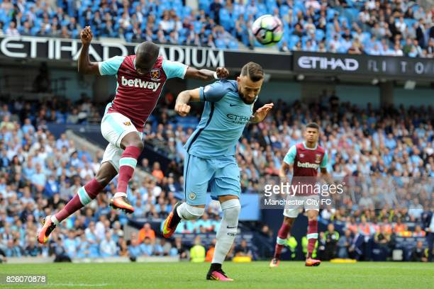 Manchester City's Nicolas Otamendi and West Ham United's Cheikhou Kouyate in action during the Barclay's Premiership match at the Etihad Stadium...