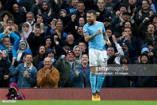 Manchester City's Nicolas Otamendi celebrates scoring his side's second goal during the Premier League match at the Etihad Stadium Manchester