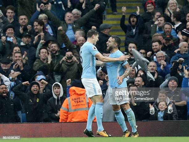 Manchester City's Nicolas Otamendi celebrates scoring his side's third goal with teammate John Stones during the Premier League match between...
