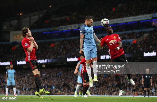 Manchester City's Nicolas Otamendi has a header on goal but is blocked by Manchester United's Eric Bailly