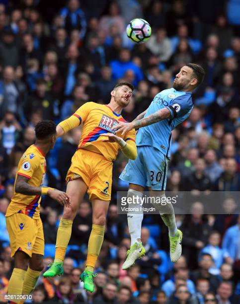 Manchester City's Nicolas Otamendi heads at goal as Crystal Palace's Joel Ward challenges