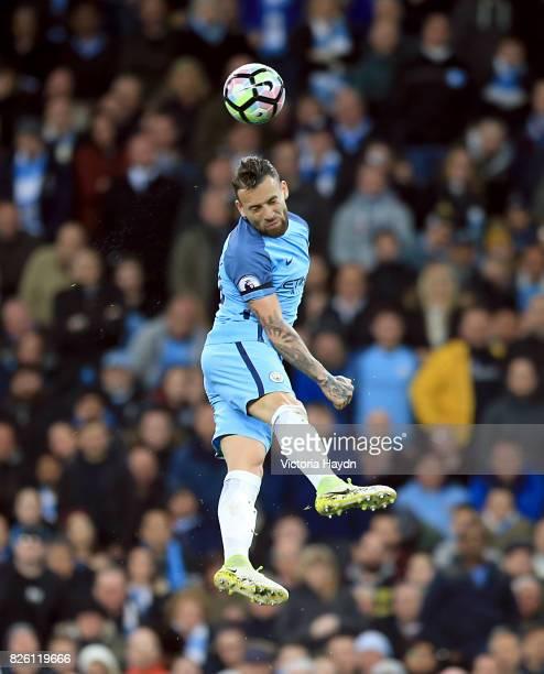 Manchester City's Nicolas Otamendi heads the ball in the air