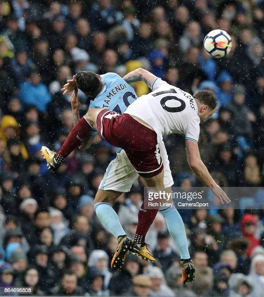 Manchester City's Nicolas Otamendi is fouled by Burnley's Ashley Barnes who received a yellow card for the offence during the Premier League match...
